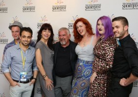 Filmmakers are photographed with Darryl Macdonald, center, executive director of the Palm Springs International ShortFest, during the Opening Night: Make 'Em Laugh program at the Camelot Theatres in Palm Springs on Tuesday. (Photo: Taya Gray/Special to The Desert Sun)